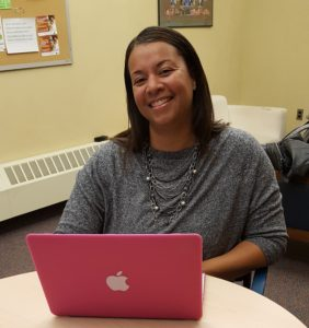 Photo of a smiling grantee with a laptop